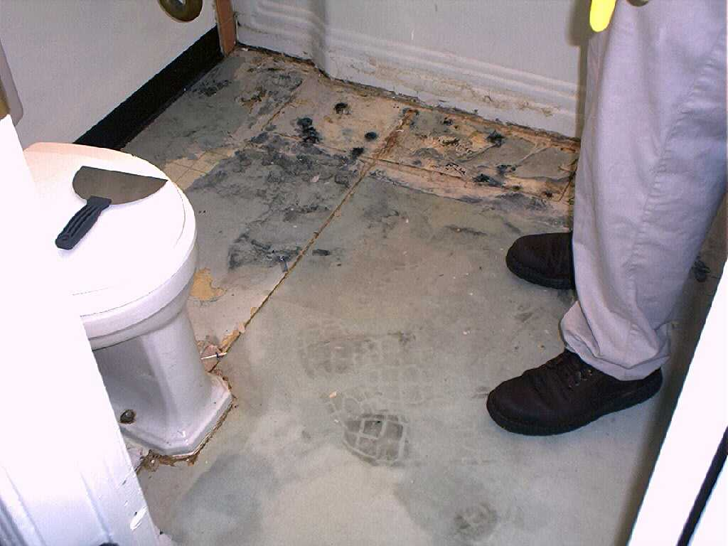 We pulled up that next layer of linoleum and found more for How to install linoleum floor in bathroom
